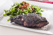 pic of ribeye steak  - Prime ribeye steak served with spinach sauteed in olive oil with garlic and bacon bits - JPG