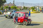 MOLLENDO, PERU, MAY 20, 2014: Mototaxi drive down the street