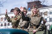 Attractive girls in uniform of times WW2 on parade