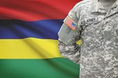 American Soldier With Flag On Background - Mauritius