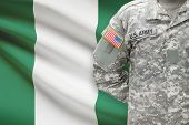 American Soldier With Flag On Background - Nigeria