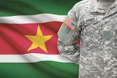 picture of suriname  - American soldier with flag on background  - JPG