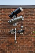 Surveillance Camera on brick wall