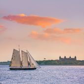 New York sailboat sunset and Ellis Island from Manhattan US