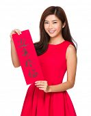 Woman hold with Fai Chun for chinese new year, phrase meaning is blessing good luck