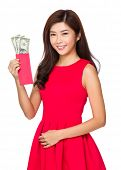 Woman hold red pocket of USD