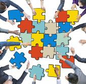 Group of Business People Forming Jigsaw Puzzle
