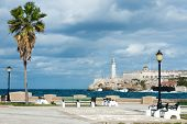 foto of el morro castle  - The castle of El Morro in Havana with a beautiful park with tropical palm trees on the foreground - JPG