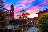 Parish church and houses in small town of Serralunga d'Alba early in the morning in Piedmont, Northern Italy.