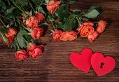 Roses and hearts shape with copy space on wooden background. Valentines day background. Love