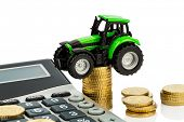 farmers in agriculture have to reckon with rising costs. higher prices for food, fertilizer and plants. tractor with coins and calculator