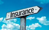 Insurance sign with sky background