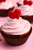 Delicious cupcake for Valentine Day on pink background