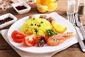 Seafood Paella on plate on table close-up
