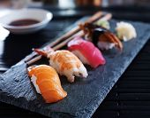 assorted sushi nigiri on slate