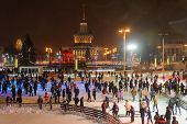 People Skating At Park On Winter Nigh
