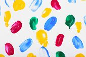 Colorful paint strokes on sheet of paper background