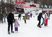 Adults And Children Skating In Park