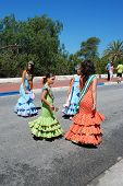 Spanish girls in flamenco dresses.