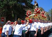 Carrying float through Marbella streets.
