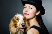 Portrait of a beautiful young woman and Russian Spaniel