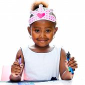 Cute Afro Girl Holding Wax Crayons.