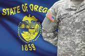 American Soldier With Us State Flag On Background - Oregon