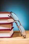 Books  And  Glasses On Wooden Table