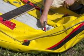 foto of raft  - The man pumped yellow rubber boat preparing for Rafting - JPG