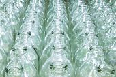 Clear glass bottle filled with water placed