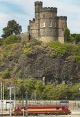 Antique Tower And Train Line In Edinburgh, Scotland. Uk