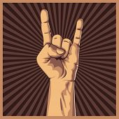 Hand in rock sign background.