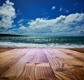 wooden table on the beach with sea backgroung