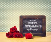 Happy Womans Day Message Written On Little Chalkboard