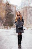 Winter full length portrait of a cute redhead lady