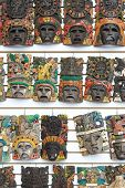 Mayan woodeMayan wooden handcrafted masks on the street market in Cacun, Mexico.n handcrafted masks on the street market in Cacun, Mexico.