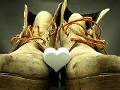 Pair Of Heavy Military Boots And White Heart.