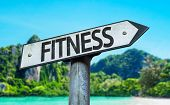 Fitness sign with a beach on background