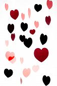 Group Of Colorful Pink And Red Hearts Isolated Over White Background Vertical