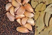 pic of peppercorns  - Top view of garlic bay leaves and peppercorns background - JPG
