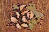 stock photo of peppercorns  - Heap of garlic bay leaves and peppercorns - JPG