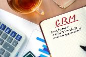 picture of customer relationship management  - Notepad with word CRM customer relationship management concept and marker - JPG