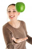 picture of juggling  - Woman juggling with green apple isolated on white background - JPG