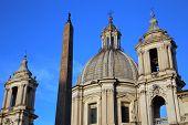 stock photo of obelisk  - Saint Agnese in Agone with Egypts obelisk in Piazza Navona Rome Italy - JPG