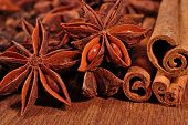 foto of cinnamon sticks  - Star anise and cinnamon sticks on a wooden background - JPG