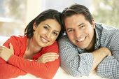 pic of hispanic  - Hispanic Couple Relaxing At Home On Sofa - JPG
