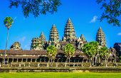 pic of raider  - Angkor Wat temple with palms and reflection in the lake over the blue sky in sunny day, Siem Reap,  Cambodia