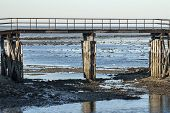 image of tide  - Low tide exposes mudflats in Plymouth harbor - JPG