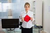 image of tears  - Portrait Of Young Businesswoman Tearing Her Shirt Revealing A Superhero Suit - JPG