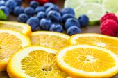 stock photo of infusion  - Sliced fresh organic fruits prepared to make infused water. ** Note: Shallow depth of field - JPG